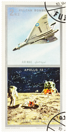 MOSCOW, RUSSIA - January 25, 2017: A stamp printed in Fujeira shows spacecraft Apollo 12 on the Moon and Vulcan bomber, series Air and Space Vehicles, circa 1971