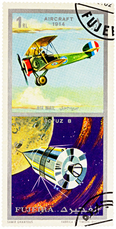 MOSCOW, RUSSIA - January 25, 2017: A stamp printed in Fujeira shows Russian spacecraft Soyuz 8 and ancient aircraft (1914), series Air and Space Vehicles, circa 1971 Editorial