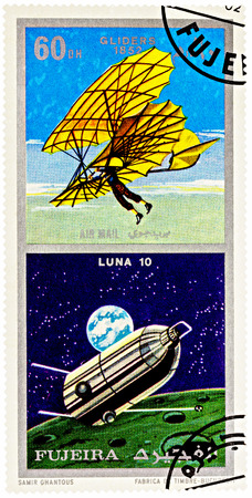 MOSCOW, RUSSIA - January 25, 2017: A stamp printed in Fujeira shows spacecraft Luna 10 and ancient glider (1852), series Air and Space Vehicles, circa 1971