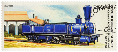 "MOSCOW, RUSSIA - January 26, 2017: A stamp printed in Guinea, shows old steam locomotive Genf Swiss Central Railway (1858), series ""Rail Transport"", circa 1996"