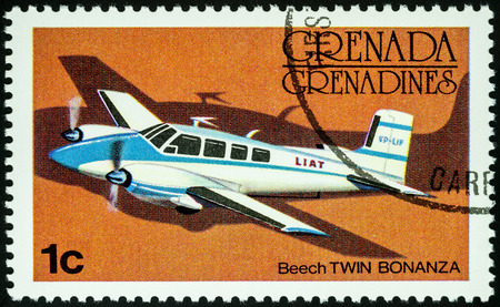 Moscow, Russia - July 04, 2017: A stamp printed in Grenada shows small passenger aircraft Beech Twin Bonanza, series, circa 1976 Editorial