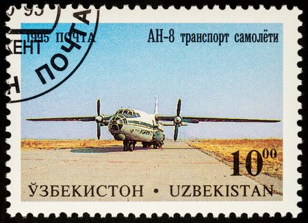 postmark: Moscow, Russia - July 05, 2017: A stamp printed in Uzbekistan shows transport plane Antonov AN-8, series Aircraft of Tashkents Aircraft Factory, circa 1995