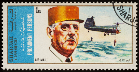 Moscow, Russia - July 09, 2017: A stamp printed in Sharjah shows President of France Charles de Gaulle and helicopter, series Charles de Gaulle and Aircraft, circa 1972