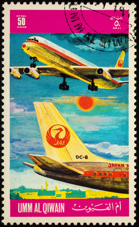 Moscow, Russia - July 10, 2017: A stamp printed in Umm al-Quwain shows passenger airliner Douglas DC-8 of JAL (Japan Airlines), series International Airlines, circa 1972