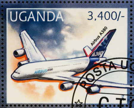 postmark: Moscow, Russia - July 10, 2017: A stamp printed in Uganda shows passenger airliner Airbus A330, series Transport - Airplanes, circa 2012