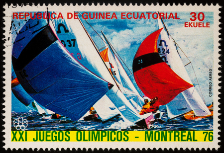 Moscow, Russia - July 21, 2017: A stamp printed in Equatorial Guinea shows sailing regatta, series Olympic Games - Montreal, Canada, circa 1976