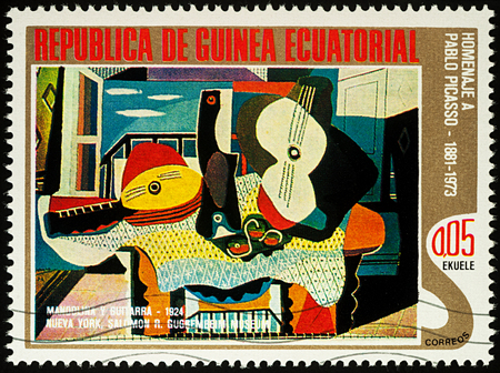 Moscow, Russia - July 27, 2017: A stamp printed in Equatorial Guinea, shows painting Mandolin and guitar by Pablo Picasso, series Picasso: Abstract paintings, circa 1975