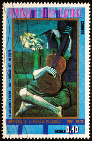 Moscow, Russia - July 28, 2017: A stamp printed in Equatorial Guinea, shows painting The Old Guitarist by Pablo Picasso, series Picasso: Paintings of the blue period, circa 1973