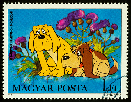 Moscow, Russia - July 31, 2017: A stamp printed in Hungary shows two dogs, series Cartoons - Vuk, the Little Fox, circa 1982