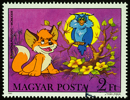 Moscow, Russia - July 31, 2017: A stamp printed in Hungary shows Owl and little fox, series Cartoons - Vuk, the Little Fox, circa 1982