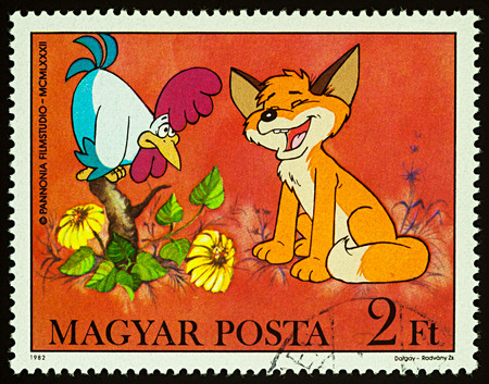 Moscow, Russia - July 31, 2017: A stamp printed in Hungary shows rooster and little fox, series