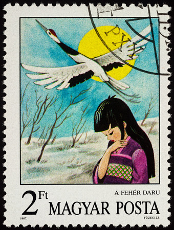 Moscow, Russia - July 30, 2017: A stamp printed in Hungary shows scene from the Japanese fairy tale The White Crane, series Stories and Fairy Tales, circa 1987