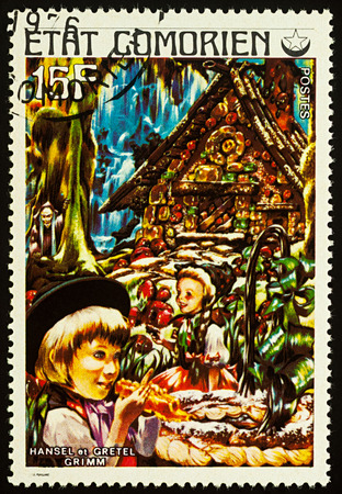 Moscow, Russia - August 02, 2017: A stamp printed in Comoros shows scene from a fairy tale Hansel and Gretel, series Childrens Book, circa 1976