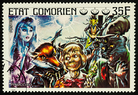 Moscow, Russia - August 02, 2017: A stamp printed in Comoros shows scene from a fairy tale Pinocchio, series Childrens Book, circa 1976