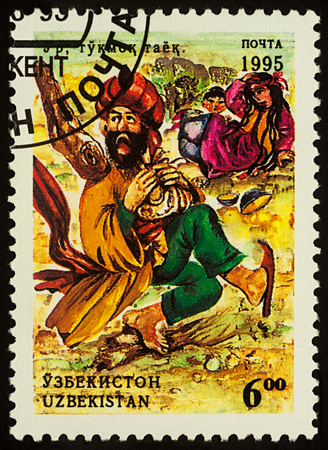 Moscow, Russia - August 02, 2017: A stamp printed in Uzbekistan shows scene from Asian fairy tale The fool, series Folk Tales, circa 1995