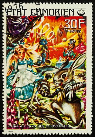 Moscow, Russia - August 02, 2017: A stamp printed in Comoros shows scene from a fairy tale Alice in wonderland, series Childrens Book, circa 1976