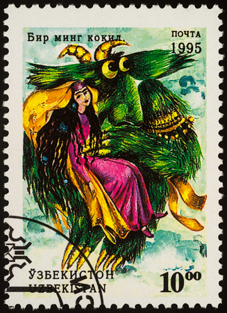 Moscow, Russia - August 02, 2017: A stamp printed in Uzbekistan shows woman and monster bird, a scene from Asian fairy tale Thousand plaits, series Folk Tales, circa 1995