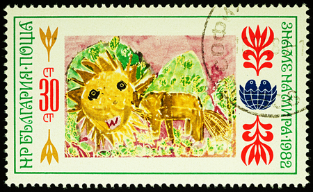 Moscow, Russia - August 03, 2017: A stamp printed in Bulgaria shows childrens drawing of lion, series International Childrens Assembly Banner of Peace, circa 1982 Editorial