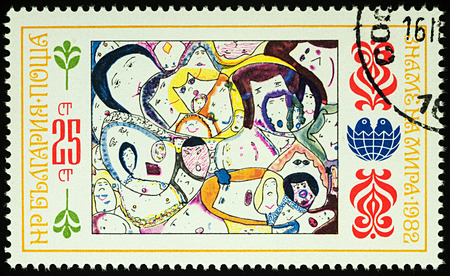 Moscow, Russia - August 03, 2017: A stamp printed in Bulgaria shows childrens drawing of peoples faces, series International Childrens Assembly Banner of Peace, circa 1982