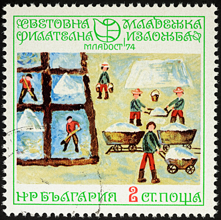 Moscow, Russia - August 04, 2017: A stamp printed in Bulgaria shows childrens drawing of Salt huts, working people, series Youth Stamp Exhibition 74: Childrens Drawings, circa 1974