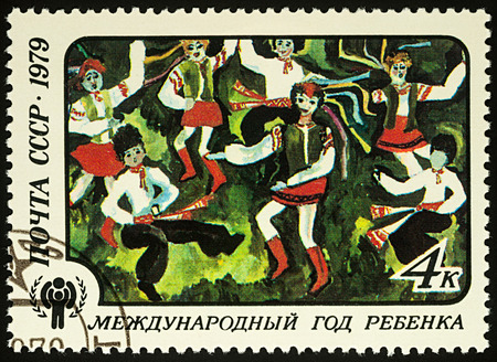 Moscow, Russia - August 04, 2017: A stamp printed in USSR (Russia) shows childrens drawing The Dance of Friendship, series International year of the child, circa 1979
