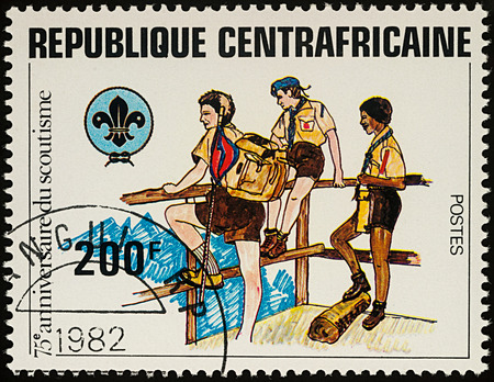 Moscow, Russia - August 04, 2017: A stamp printed in Central African Republic shows three Boy Scouts, series The 75th Anniversary of Boy Scout Movement, circa 1982