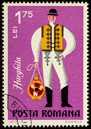 Moscow, Russia - August 08, 2017: A stamp printed in Romania, shows young man in Romanian folklore costume, Harghita county, series Folklore costumes, circa 1973 Editorial