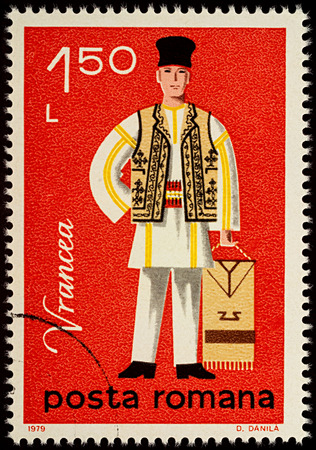 Moscow, Russia - August 08, 2017: A stamp printed in Romania, shows young man in Romanian folklore costume, Vrancea county, series