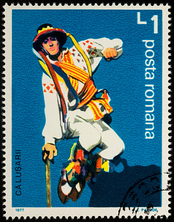 Moscow, Russia - August 08, 2017: A stamp printed in Romania, shows Romanian folk dancer, series Folk Dancers, circa 1977 Editorial