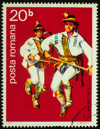 Moscow, Russia - August 08, 2017: A stamp printed in Romania, shows two Romanian folk dancers, series Folk Dancers, circa 1977