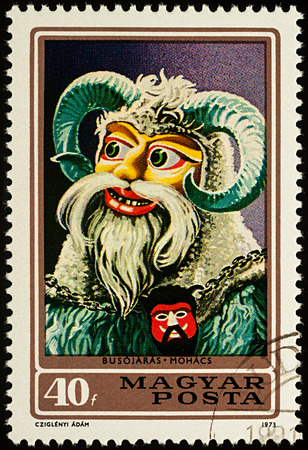 Moscow, Russia - August 06, 2017: A stamp printed in Hungary, shows Hungarian carnival mask, series Busho Walk in Mohacs - Masks, circa 1973