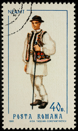 Moscow, Russia - August 08, 2017: A stamp printed in Romania, shows young man in Romanian national costume, Neamt county, series Folk costumes, circa 1968 Editorial