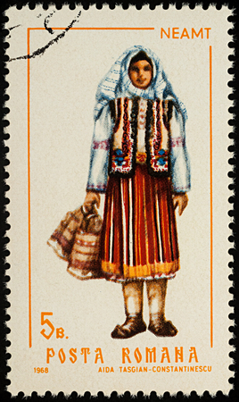 Moscow, Russia - August 08, 2017: A stamp printed in Romania, shows young woman in Romanian national costume, Neamt county, series Folk costumes, circa 1968