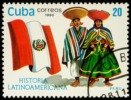 Moscow, Russia - August 10, 2017: A stamp printed in Cuba, shows national flag and a couple in traditional costumes of Peru, series Editorial