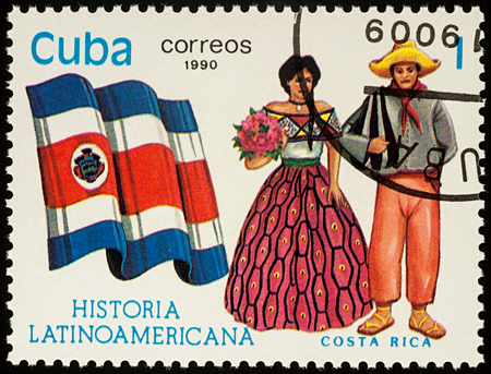Moscow, Russia - August 09, 2017: A stamp printed in Cuba, shows national flag and a couple in traditional costumes of Costa Rica, series Editorial