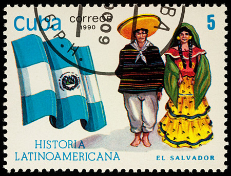 Moscow, Russia - August 10, 2017: A stamp printed in Cuba, shows national flag and a couple in traditional costumes of El Salvador, series Editorial