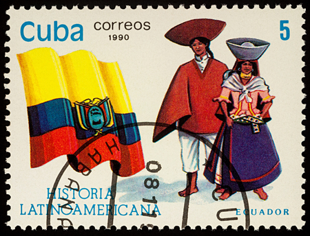 Moscow, Russia - August 09, 2017: A stamp printed in Cuba, shows national flag and a couple in traditional costumes of Ecuador, series