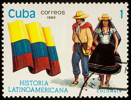 Moscow, Russia - August 09, 2017: A stamp printed in Cuba, shows national flag and a couple in traditional costumes of Colombia, series