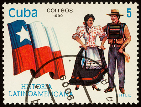 Moscow, Russia - August 10, 2017: A stamp printed in Cuba, shows national flag and a couple in traditional costumes of Chile, series Editorial