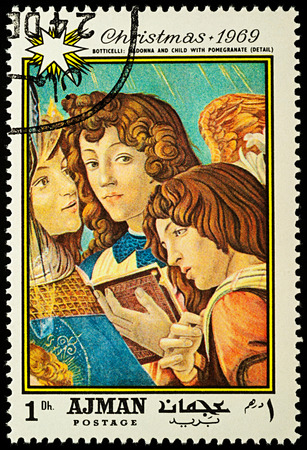Moscow, Russia - August 20, 2017: A stamp printed in Ajman, shows painting Madonna with the pomegranate (detail) by Sandro Botticelli (1445-1510), series Christmas - Paintings, circa 1969 Editorial