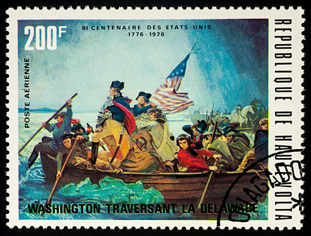 Moscow, Russia - September 04, 2017: A stamp printed in Upper Volta (Burkina Faso), shows George Washington crossing Delaware River, series American Revolution Bicentenary, circa 1975