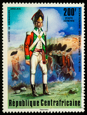 old english: Moscow, Russia - September 05, 2017: A stamp printed in Central African Empire, shows English Grenadier Officer, series The 200th Anniversary of American Revolution, circa 1976