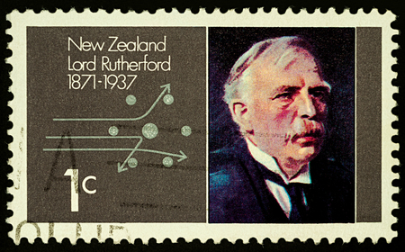 Moscow, Russia - September 07, 2017: A stamp printed in New Zealand, shows famous physicist Ernest Rutherford and scheme of diffusion of alpha particles, circa 1971