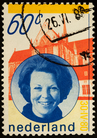Moscow, Russia - November 04, 2017: A stamp printed in Netherlands shows portrait of Netherlandish Queen Beatrix, circa 1980 Editorial