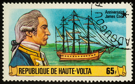 discoverer: Moscow, Russia - November 07, 2017: A stamp printed in Upper Volta shows Captain James Cook and his ship Resolution, series The 250th Anniversary of the Birth of James Cook, 1728-1779, circa 1978 Editorial