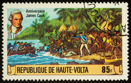 Moscow, Russia - November 08, 2017: A stamp printed in Upper Volta shows landing of James Cooks team on a tropical island, series 250th Anniversary of the Birth of James Cook, 1728-1779, circa 1978