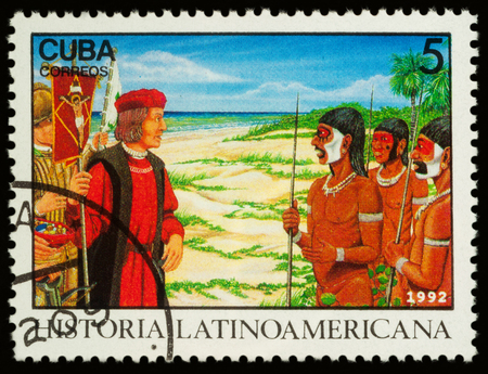 Moscow, Russia - November 16, 2017: A stamp printed in Cuba shows Columbuss meeting natives in New World (1492), series Latin american history, circa 1992