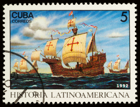 Moscow, Russia - November 16, 2017: A stamp printed in Cuba shows three ships of Christopher Columbus expedition stopping at Canary Islands, series Latin American history, circa 1992