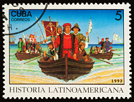 Moscow, Russia - November 16, 2017: A stamp printed in Cuba shows Christopher Columbus and  his crew in boats landing in New World in 1492, series Latin american history, circa 1992
