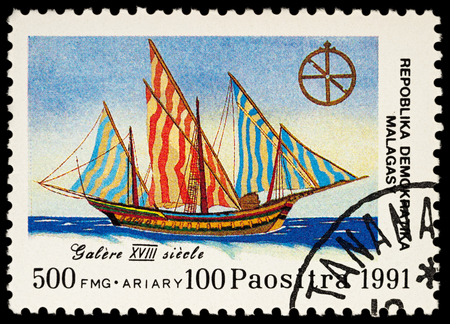 Moscow, Russia - November 19, 2017: A stamp printed in Madagascar shows sailing ship galley (XVIII century), series Discovery of America, circa 1991